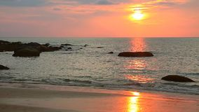 Tropical sunset at the beach. Rocks at topical beach at beautiful sunset. Nature background stock video footage