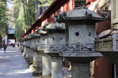 Rocks and toros lighting around Futarasan Shrine, in the compl. Ex of Toshogu Temple. Taken in Nikko, February 2018 royalty free stock photos