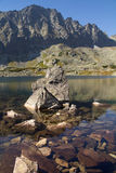 Rocks in a tranquil mountain lake Royalty Free Stock Images