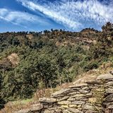 Rocks, trees & clouds. Himalayan hillside view near Pokhara, Nepal Stock Images