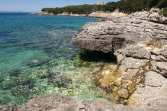Rocks and turquoise blue water at Capo Testa Royalty Free Stock Images