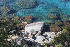 Rocks in the Turquoise Lake Stock Photography