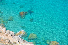 Rocks and turquoise sea Royalty Free Stock Image
