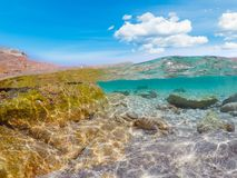 Rocks and turquoise water in Porto Istana Stock Photos