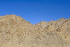 Rocks under a blue sky Stock Image
