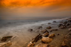 Rocks under an orange sunset Royalty Free Stock Photo
