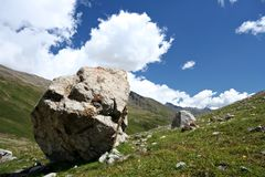 Rocks in valley,Caucasus mountains.Blue sky,clouds Royalty Free Stock Photography