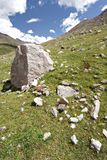 Rocks in valley,Caucasus mountains.Blue sky,clouds Stock Images