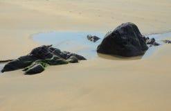 Rocks in velvet sand Stock Photo