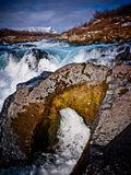 Rocks and water. Photo from river named Bruara located south east in Iceland. Water brake its way straight through the rocks Stock Images