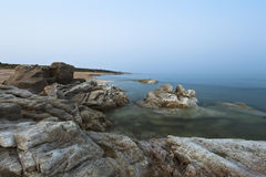 Rocks and water. A pile of rocks on a beach near Taili harbor, Xingcheng, northeast China Royalty Free Stock Photography