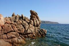 Rocks in the water. Of Capo Coda Cavallo, Scogli nelle acque di Capo Coda Cavallo Sardegna royalty free stock image
