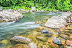 Rocks and water on the Chattooga Wild and Scenic River. Shoals near Bull Sluice rapid, on the Chattooga river. Popular with whitewater boaters, rafting and stock image