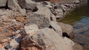 Rocks in the water. Rocks just beside of the water Stock Photos