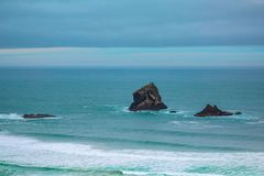 Rocks in the water at Sandfly Bay, Otago Peninsula, South Island, New Zealand stock images