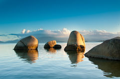Rocks, water, sky and cloud at sunset Stock Image