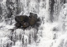 Rocks in waterfall Stock Photo