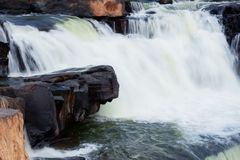 Rocks on the waterfall. Rocks on waterfall with the freshness of nature Stock Images