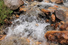 Rocks in waterfall Stock Images