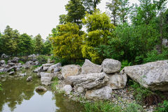 Rocks at waterside in spring Royalty Free Stock Images