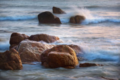 Rocks and waves. At Kuantan Malaysia stock photography