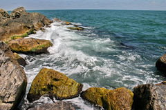 Rocks and waves Stock Images