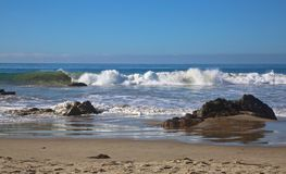 Rocks waves beach Stock Photos