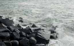 Rocks with waves. Rocks on the beach landscape at tharangambadi, tamilnadu, india Royalty Free Stock Photo