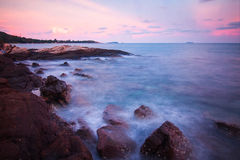 Rocks waves and the beautiful sunset Stock Image