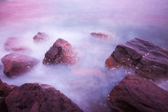 Rocks waves and the beautiful sunset Royalty Free Stock Photos
