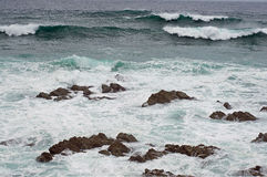 Rocks and waves Stock Image