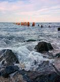 Seascape with rocks, waves and columns. Rocks, waves, columns and sky with clouds Royalty Free Stock Image