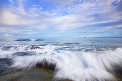Rocks and waves at Kings Beach, QLD. Stock Images