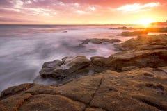 Rocks and waves at Kings Beach, QLD. Stock Photos