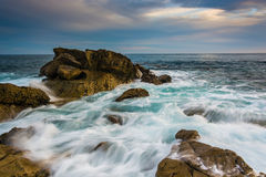 Rocks and waves in the Pacific Ocean at Monument Point, Heisler Stock Photo