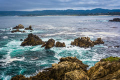 Rocks and waves in the Pacific Ocean, seen from a beach at Point Stock Photography