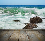 Rocks in the waves and sea foam. Royalty Free Stock Photo
