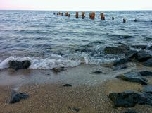 Seascape with rocks and waves. Rocks and waves on sea shore Stock Image