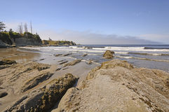 Rocks and Waves on a Sheltered Beach Stock Photos