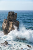 Rocks and waves of surf in the ocean near Cabo Carvoeiro, Penich Stock Image