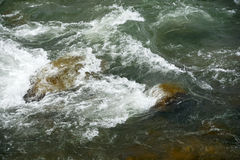 Rocks and waves in a torrent Stock Photo