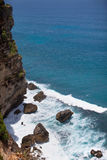 Rocks and waves. View rocks and waves in Bali royalty free stock photos