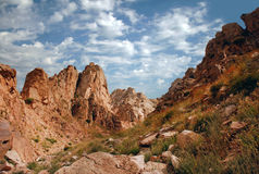 Rocks of the Western Tien Shan in August, with clouds Royalty Free Stock Images
