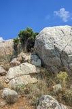 Rocks, which snap into the sea near Balaklava. Stock Photos