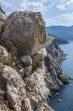 Rocks, which snap into the sea near Balaklava. Royalty Free Stock Photo