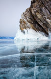 Rocks on winter Baikal lake Stock Photos