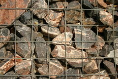 Rocks in wire. Breakwater rocks in wire mesh Royalty Free Stock Photography