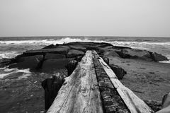Black and White of wood jetty at Bethany Beach Delaware Stock Images