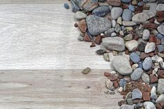 Rocks and wood. Rocks and stones at wood background decor Stock Images