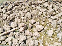 The rocks and wreckage, after the water of the river down. Stock Photography
